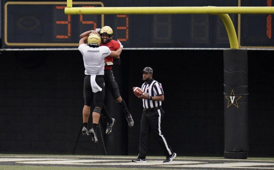 Cam Johnson and Mike Wright embrace after a touchdown in Vanderbilt's spring game. (Vanderbilt Athletics).