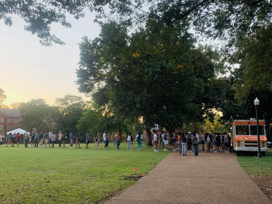line on alumni lawn in front of food truck