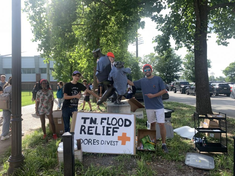 members of dores divest hosting a flood relief drive outside the red