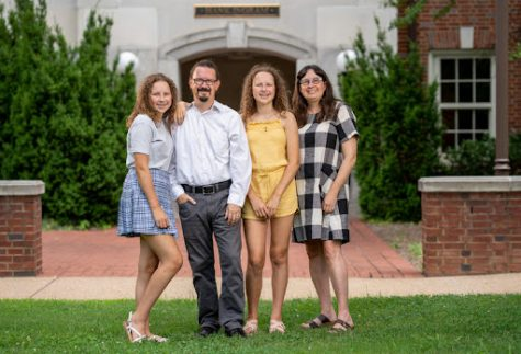 Dr. Eric Barth and his family standing outside the front of Hank Ingram House