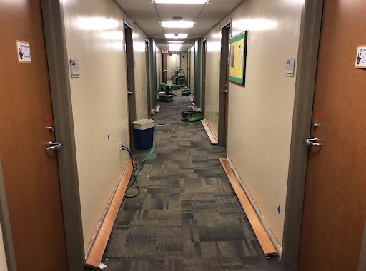 damage to gillette; removed baseboards and vacuums in hallway