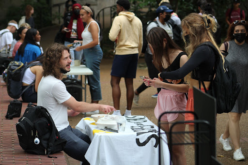 swipes for a cause table outside of Rand