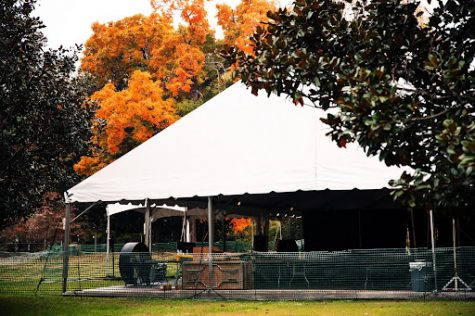 tent on library lawn with foliage in the back