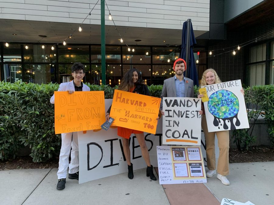 students holding sings at divest protest