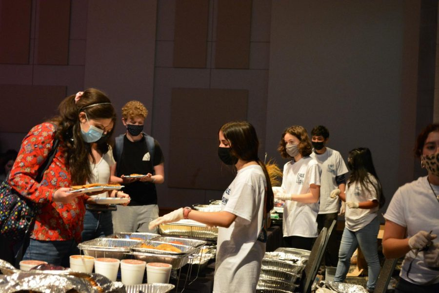Students serving food at Sabor Latino, an event organized by the Association of Latin American Students, as photographed Oct. 6, 2021. (Photo Courtesy of Shelby Keuhnle)