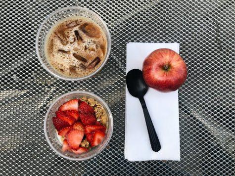 An iced coffee, a parfait, and an apple from Grins Café